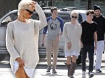 We get it you's married! Newlywed Pamela Anderson flashes some leg as she once again wears white to take all her men to lunch