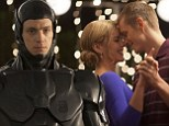 The last dance: Joel Kinnaman enjoys tender moment with Abbie Cornish before his cyborg transformation in new RoboCop film stills