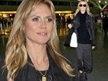 Heidi Klum is smiling and stylish as she jets into New York following reports of split from beau Martin Kirsten