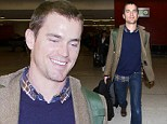 Not wearing a White Collar! Matt Bomer looks like the cat that got the cream as he arrives at LAX while dressed casual chic