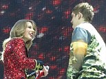 Fan club: A fan stormed the stage just for the chance to meet Taylor