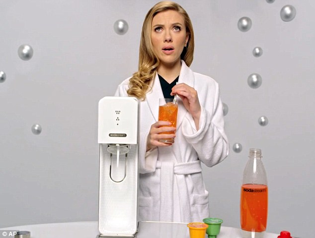 Figured it out: Scarlett Johnnsen actually says during her banned SodaStream commercial, 'How can I get this to go viral?'