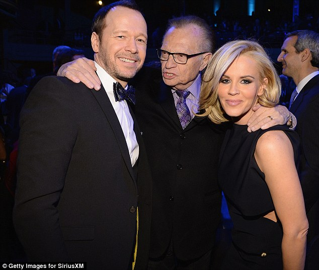 Warm embrace: Jenny and Donnie Wahlberg exchange a warm embrace with Larry King