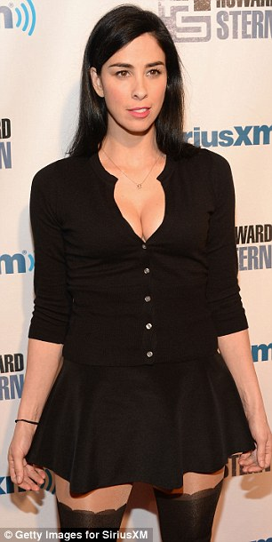 Funny ladies: Comedians Sarah Silverman and Kathy Griffin, both wearing black cleavage-baring tops, also attended