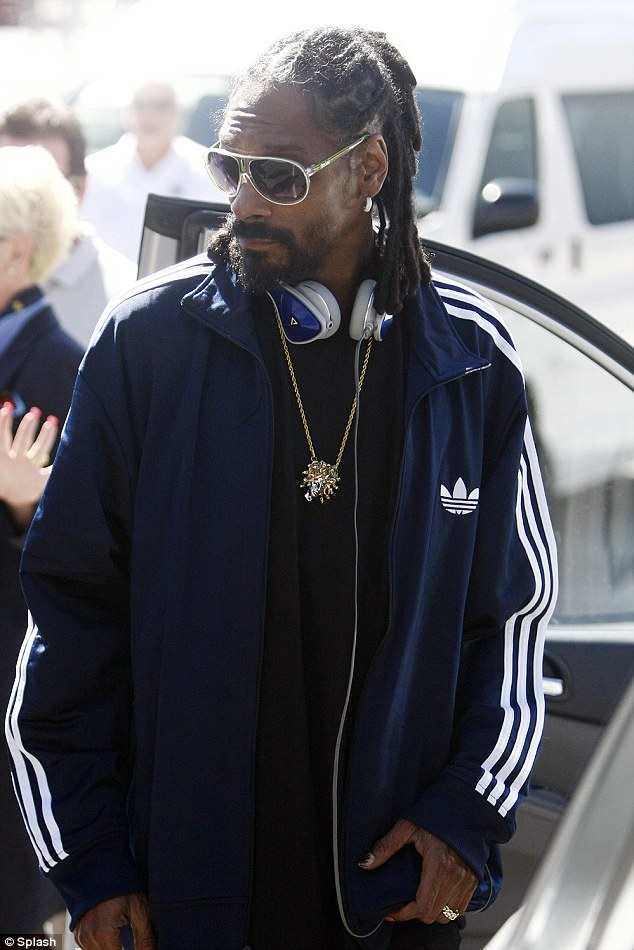 Wild man: The rapper has been growing out his beard and dreads to go with his new Rastafarian name and image