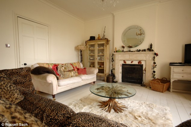 Design by Pearl: The Lowe-Goffey family snuggle up on the leopard-skin sofa on chilly evenings to watch television
