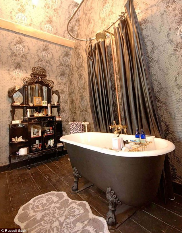 Swimming in style: Pearl refurbished the Old Rectory, including the baroque-style master en-suite bathroom, which has a roll-top bath