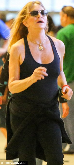 Go for it Goldie! At 68, Hawn proved that she's still in good shape as she energetically rant through the airport