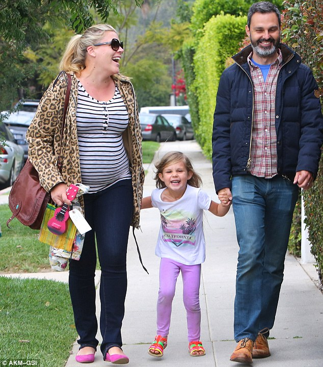 And baby makes four: The pregnant actress was all smiles as she left a party with husband Marc Silverstein and daughter Birdie last April