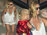 She's got good sea legs! Sarah Murdoch shows off her slender pins in a white playsuit as she carries daughter Aerin from the family's stunning $30 million yacht