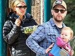 Daddy's girl: Jack Osbourne gave his daughter Pearl a push on the swing on Sunday at a park in Beverly Hills, California