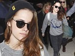 Mission accomplished! Kristen Stewart displays natural beauty and bed hair at LAX after revealing she strives to 'look like I've woken up in the last hour'