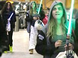 Ready, jedi go: Cara and Michelle were spotted with Star Wars style lightsabers in London