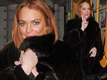 Unfurgettable! Lindsay Lohan finds missing half of $75K fur coat with a little help from Seattle Seahawks player