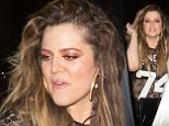 Khloe Kardashian sports pink eyeshadow while flashing her bra in black lace jersey-style T-Shirt during night out with pals