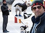 Now THAT'S puppy love! Hugh Jackman and pet pooch Dali dress in matching puffer jackets and blue shoes for family stroll