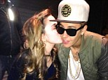 Kisses for Biebs: The hit-maker gets a peck on the cheek from a young fan