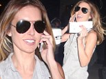 Nothing can get her down! Audrina Patridge smiles as she gets a parking ticket... after getting her hair done for FOUR hours