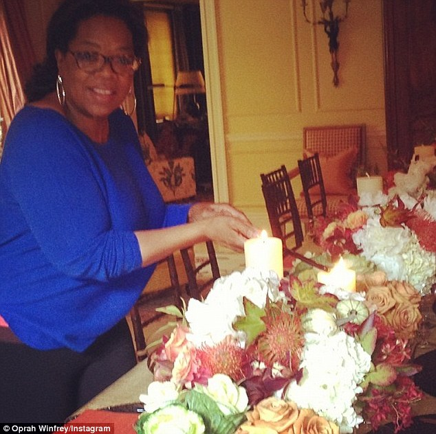The final countdown: The former talk show queen showed off her gorgeous floral table decorations as she carefully lit the candles in preparation for lunch