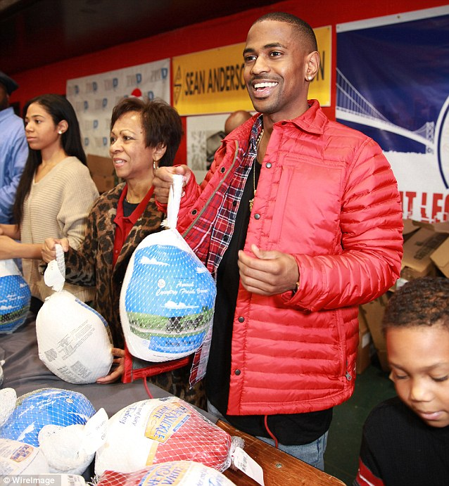 Doing good: Big Sean attends the 2013 All-Star Giveback: Thanksgiving Edition at Don Bosco Hall in Detroit, Michigan