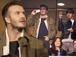 Super Bowl buddies: David Beckham and F1 driver Lewis Hamilton hang out in VIP box at star-studded event