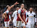 You're off: Carroll heads towards the tunnel after being shown a red card by referee Webb