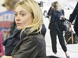 Natural beauty: Dakota Fanning is chic and makeup-free at LAX airport