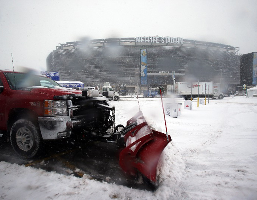 Snow causing delays for Super Bowl fans trying to fly home