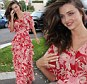Lady in red: Miranda Kerr was a vision in a floral maxi dress with layering effect in Sydney today