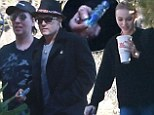 Which one's the teenager again? Johnny Depp, 50, drops daughter, 14, at school before grabbing a pipe and sloping off with Marilyn Manson