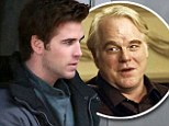 Liam Hemsworth back at work on The Hunger Games set following sudden death of co-star Philip Seymour Hoffman