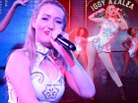 Iggy Azalea flashes her fishnet-clad pins in peplum white pants and cut-out top during racy performance