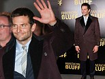 A rose by any other name: Bradley Cooper looks dapper as he arrives at French-translated American BLUFF premiere