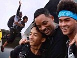 Like father, like sons! Will Smith takes his boys Jaden, 15, and Trey, 21, skydiving in Dubai... just one month after he jumped out of a plane
