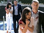 Bloody mess: Liev Schreiber escorted a bloody actress through a neighbourhood in Beverly Hills, California on Monday as they filmed a scene for the cable series Ray Donovan
