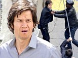 Usually buff Mark Wahlberg displays gaunt frame and hollow cheeks following 40lb weight loss while filming fight scene for new movie