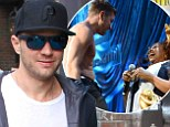 All covered up! Ryan Phillippe steps out fully clothed after shirtless lap dance at Howard Stern's birthday party