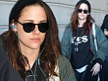 Makeup free Kristen Stewart covers up her bedhead with a beanie as she arrives in Paris