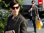 Anne Hathaway wears leather trousers