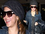 Singing superstar Shakira arrived in Los Angeles on Tuesday in a casual denim outfit after celebrating her 37th birthday in Spain.