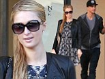 Some things never change! Paris Hilton visits designer shop with model boyfriend River Viiperi in Los Angeles