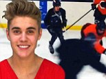Skating on thin ice! Troubled Justin Bieber is lucky to escape the sin bin after tripping opponent during hockey game