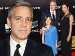 Is that your new date, George? Clooney is followed around by a little friend after promising a lucky competition winner his company