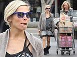 Boho bump! Elsa Pataky takes stocks up on healthy groceries at Santa Monica Whole Foods on Wednesday