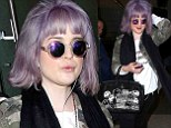Purple patch! Kelly Osbourne matches her lilac bobbed hair with hippie sunglasses as she jets into LAX