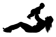 Silhouette of a woman playing with her baby
