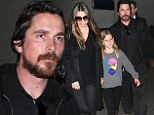 Christian Bale looks amazingly relaxed with wife Sibi and daughter Emmeline while strolling through the 'hustle' at LAX