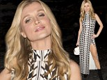 Pulling an Angelina! Joanna Krupa flashes her toned leg in fitted dress slit to the thigh on night out