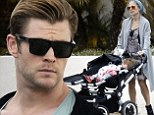 Chris Hemsworth pumps gas while his pregnant wife Elsa Pataky strolls with their daughter India Rose in LA