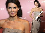 The svelte queen! Angie Harmon reigns supreme in strapless taupe dress as she's honored with award at TV festival